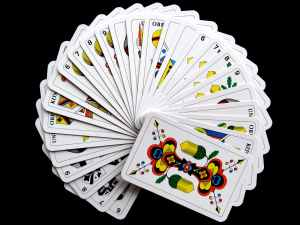 white and yellow playing cards